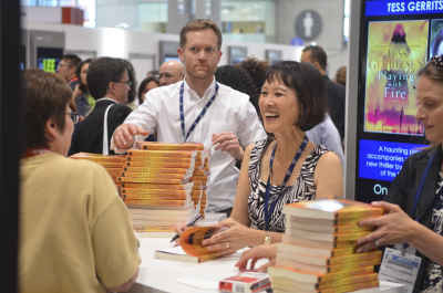 Tess Gerritsen signs ARCs of her forthcoming novel Playing with Fire